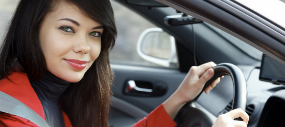 female traveller driving a car hire