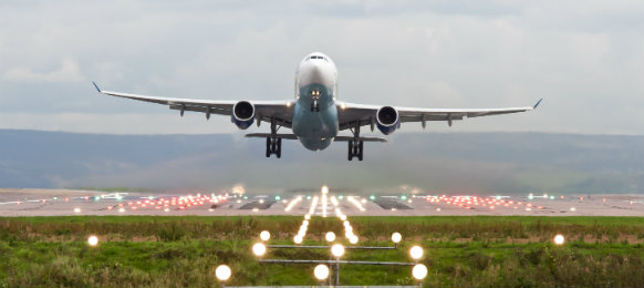airplane taking off at manchester airport