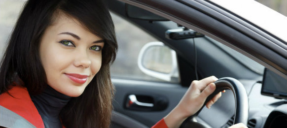 beautiful girl inside driving a car