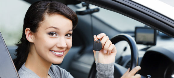 beautiful lady holding a car key