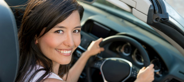 beautiful woman smiling and riding a car