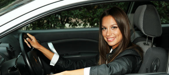 female business traveler in her car hire