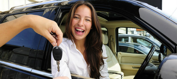 happy woman getting car key