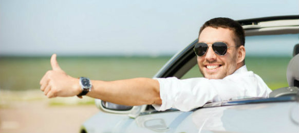 happy man thumbs up while driving a car