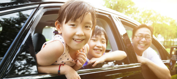 children and dad in a car hire