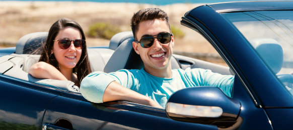 couple riding in a convertible car