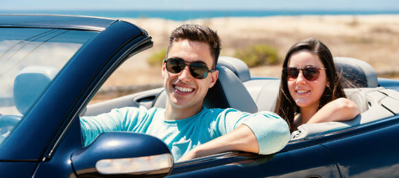 young traveling couple riding a hire car