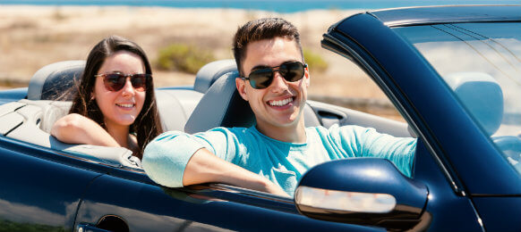 couple inside their blue car
