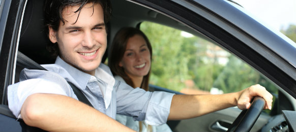 happy couple in a car hire