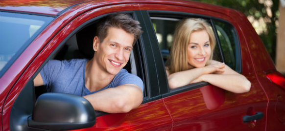 couple enjoying their car hire in gera