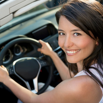 excited woman ready to explore rio with a car rental
