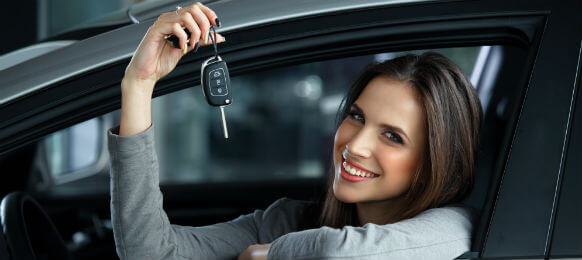 traveling business woman showing the key to her car hire