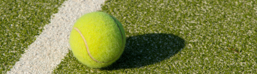 grass court with a tennis ball in Wimbledon