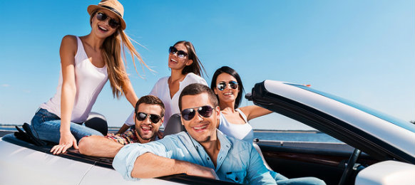 group of friends riding a car hire