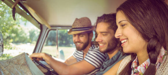 hipster friends inside a car hire