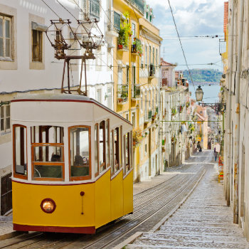 Iconic city tram travelling up Lisbon's steep hills