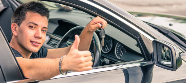 man giving a thumbs up while holding a car key