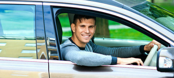 man sitting in car rental
