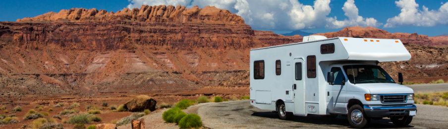 parked campervan with mountainous scenery view