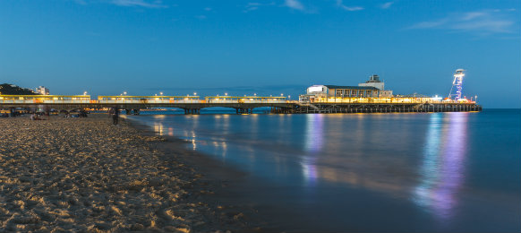 pier in bournemouth at night