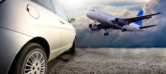 side view of a car hire and flying airplane in london gatwick airport