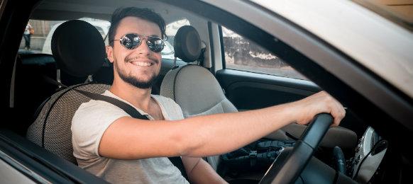 stylish man driving a car hire