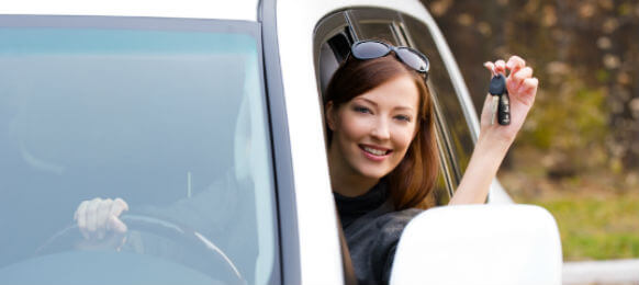 successful woman showing carhire key