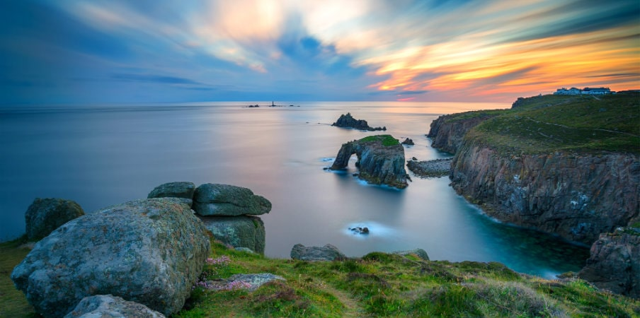 sunset at lands end in cornwall uk