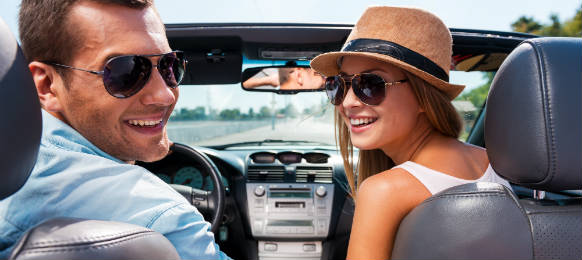 traveling couple in a convertible car hire in usmate velate