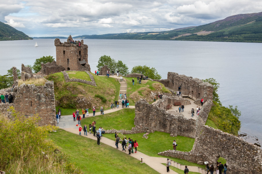 tourists visiting the urguhart castle beside loch ness