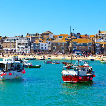 View of St. Ives harbour and beach in Cornwall, UK on a sunny day