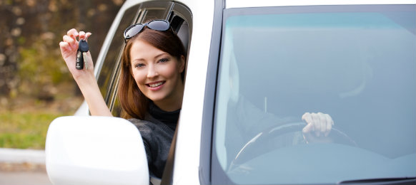 smiling woman ready to drive her new car