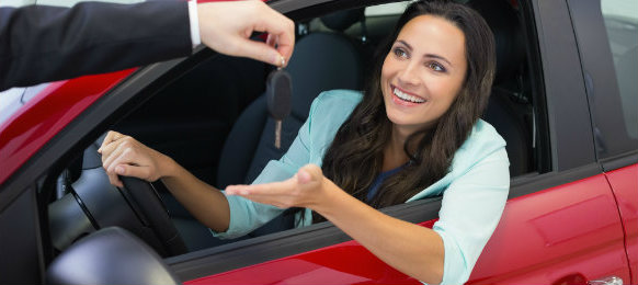 woman receiving her car key