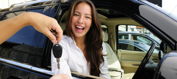 woman receiving her car key
