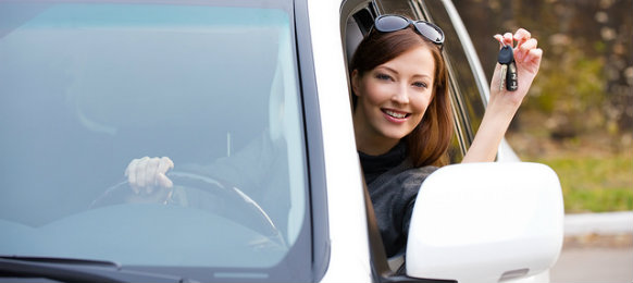 woman driving a white car hire in bolzano airport