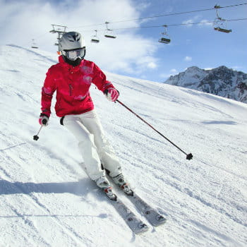Woman skiing at Nevis Mountain Range in UK