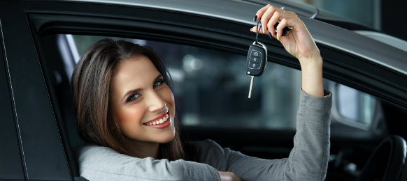 woman smiling and her holding her car key