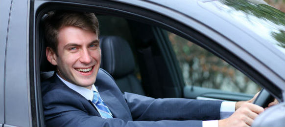 young attractive businessman in the car