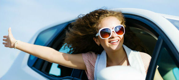 female traveler happy inside a car hire