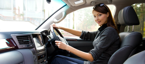 young woman driving a car hire