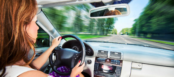 young woman driving car hire