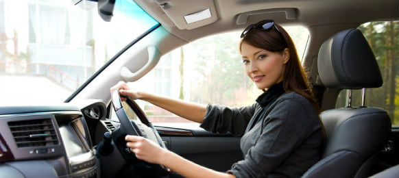 young woman in new car hire